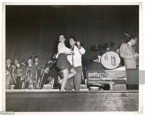 A couple dances to a big band on the bandstand 1943 Photo by Weegee/International Center of Photography/Getty Images