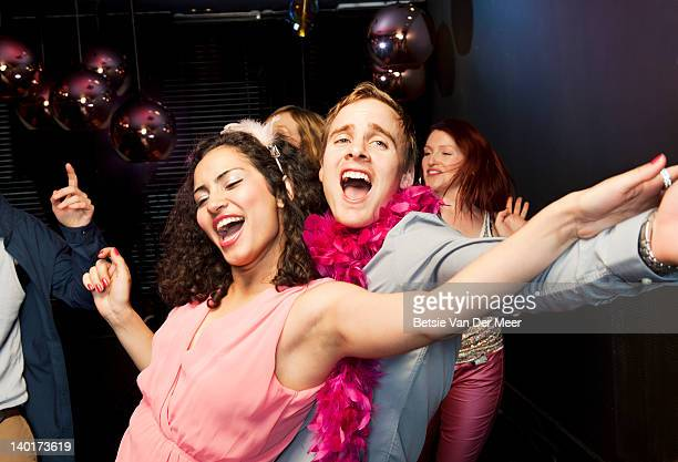 couple dancing and singing on dancefloor. - nightclub stock pictures, royalty-free photos & images