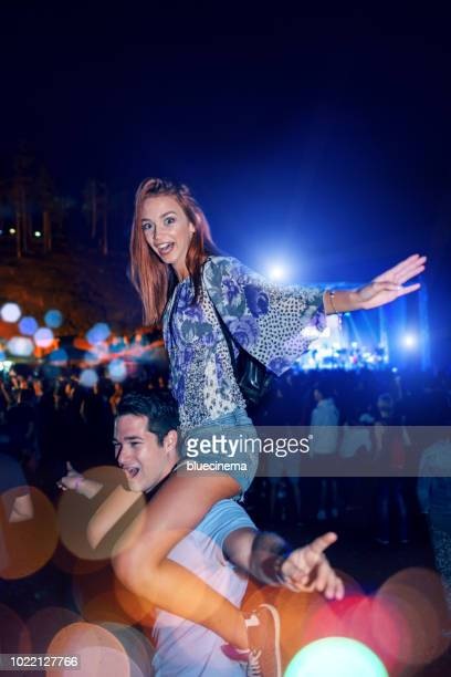 couple dancing at a concert - festival goer stock pictures, royalty-free photos & images