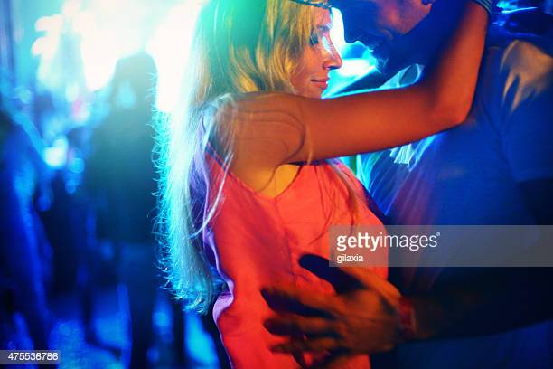 Couple dancing at concert.