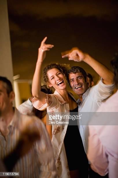 couple dancing at party at night - 30 34 anni foto e immagini stock