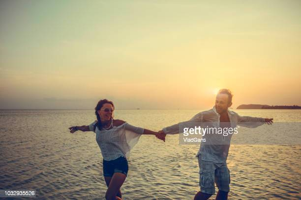 couple dancing at sunset - ballroom dancing stock pictures, royalty-free photos & images