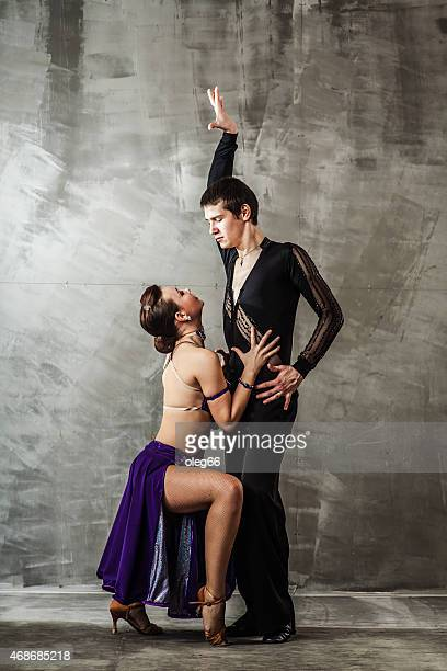 couple dancing, ballroom dancing - cha cha stock photos and pictures