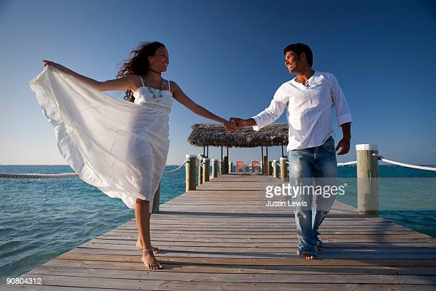 couple dancing bare foot on a dock