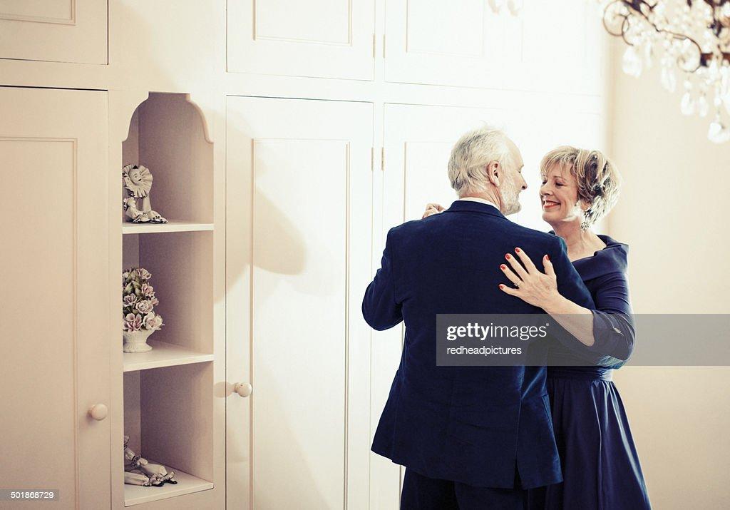 Couple dancing in bedroom : Stock Photo