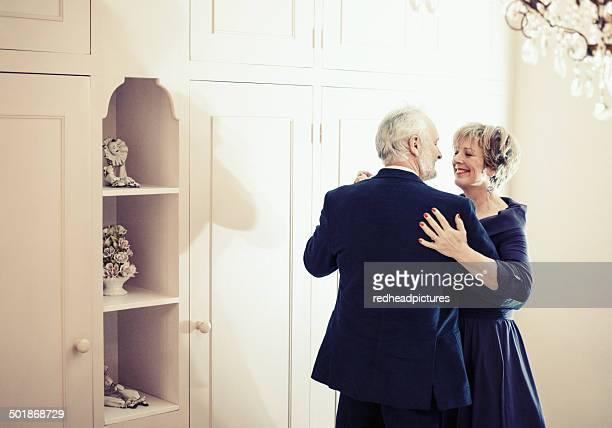 Couple dancing in bedroom