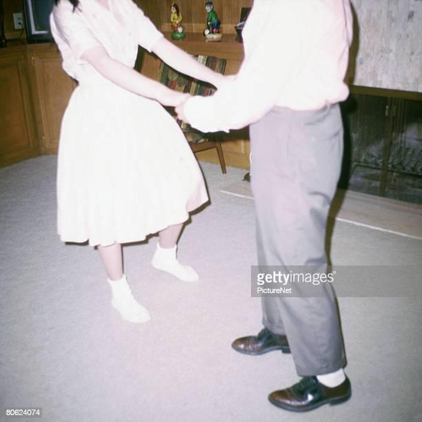 Couple Dancing in Living Room