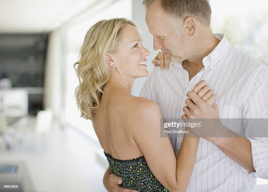 Couple dancing in living room : Stock Photo