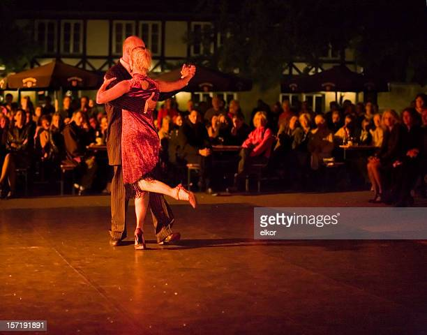 A couple dancing in the open air of Milonga at night