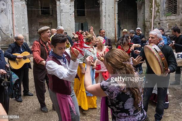 couple dancing neapolitan tarantella - traditional dancing stock photos and pictures