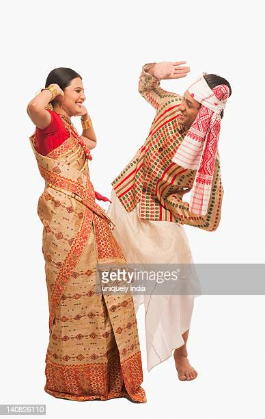 couple dancing on bihu festival - harvest festival stock pictures, royalty-free photos & images