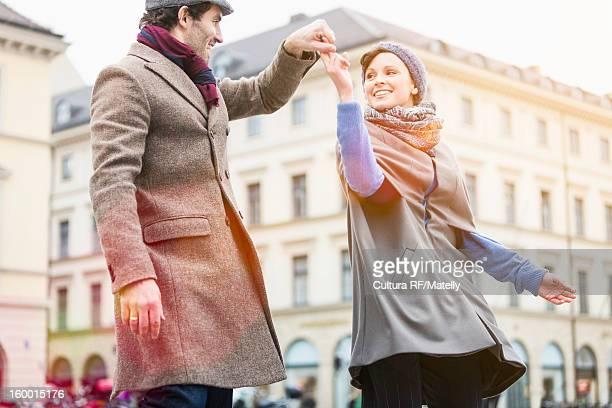 Couple dancing on city street