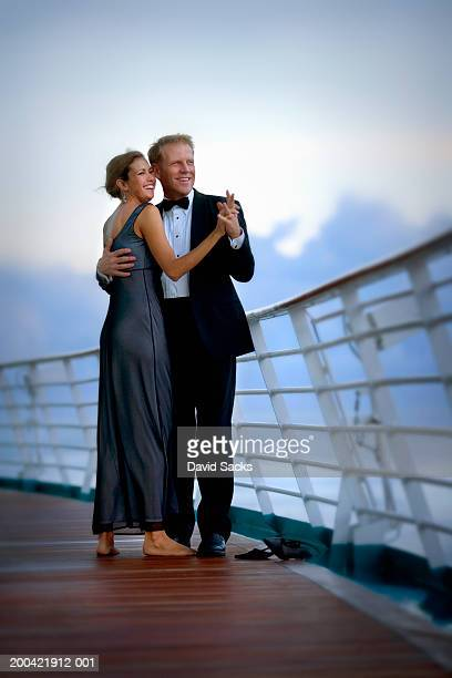 couple dancing on cruise ship, smiling - formal stock pictures, royalty-free photos & images
