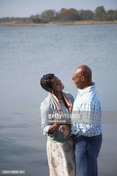 Couple dancing on dock, side view