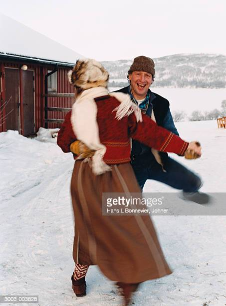 Couple Dancing on Snow