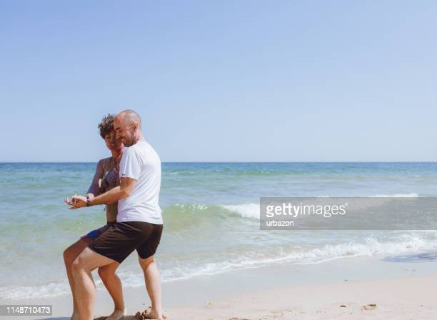 couple dancing on the beach - rumba stock photos and pictures