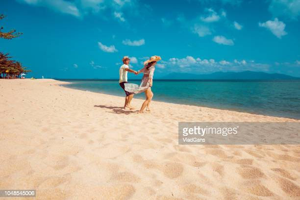 Couple dancing on tropical beach