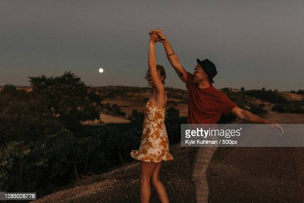 couple dancing outdoors at dusk,paso robles,ca,united states,usa - nature stock pictures, royalty-free photos & images