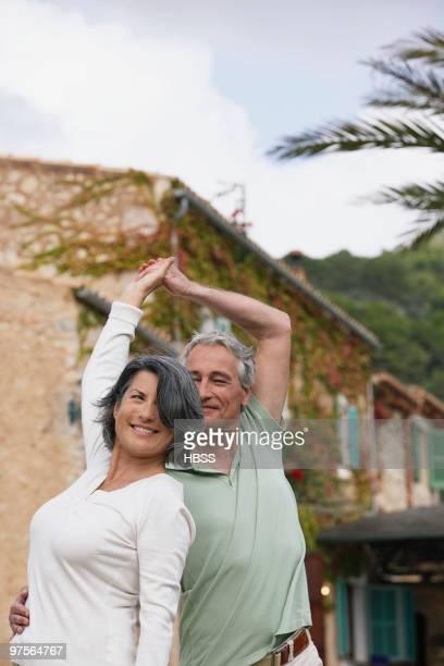 Couple dancing outdoors