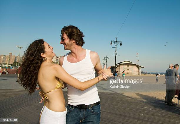 couple dancing salsa on the boardwalk - salsa dancing stock photos and pictures