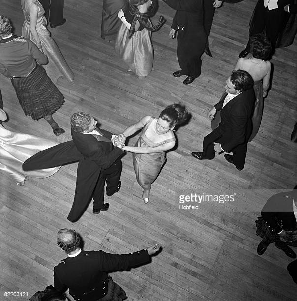 A couple dancing Scottish reels at The Royal Caledonian Ball the oldest charity ball in the world at the Grosvenor House hotel London on 10th May 1965