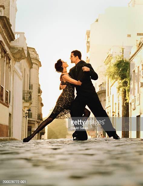 Couple dancing tango in street