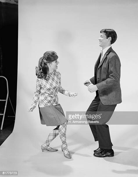couple dancing the twist. - boys wearing tights stock photos and pictures