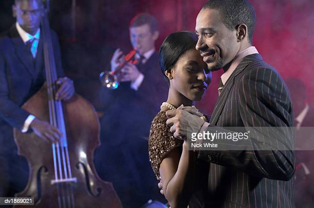 Couple Dancing to a Jazz Band in a Nightclub