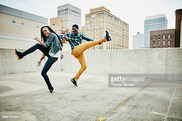 couple dancing together on rooftop of building - ダンス ストックフォトと画像