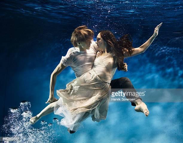 Couple dancing underwater