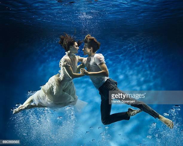A couple dancing underwater