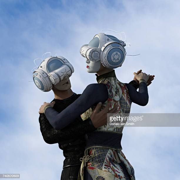 Couple dancing wearing face paint and virtual reality helmets