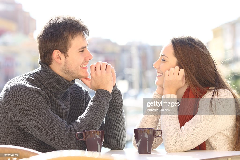 Couple dating and flirting looking each other : Stock Photo