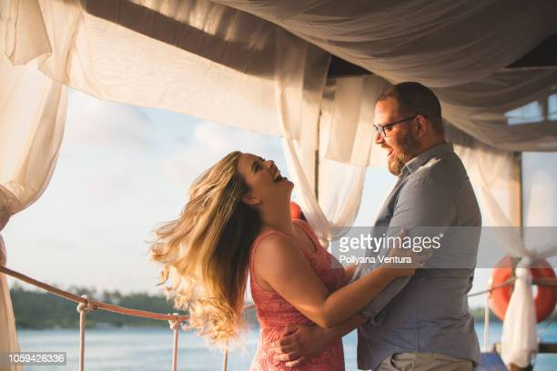 couple dating on the pier - chubby men stock photos and pictures
