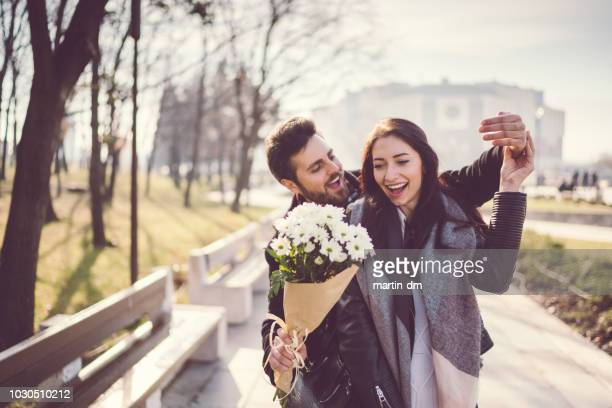 couple dating on valentine's day - giving stock pictures, royalty-free photos & images