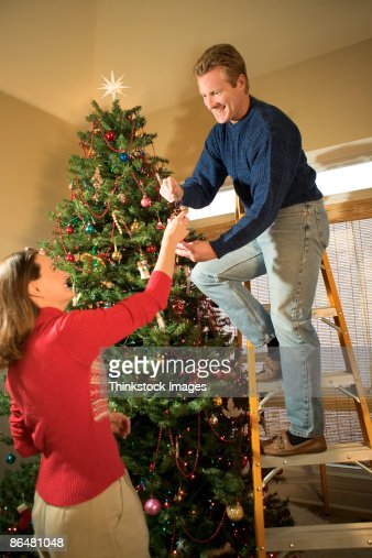 Couple Decorating Christmas Tree Stock Photo Getty Images