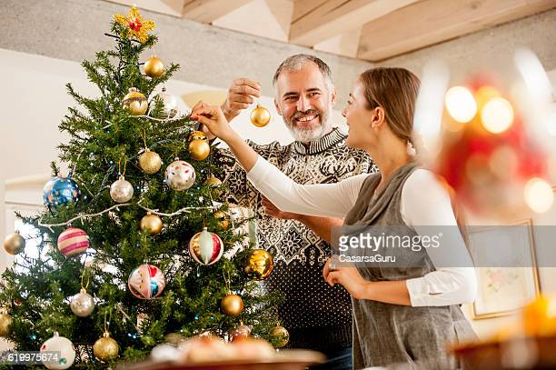 Couple Decorating the Christmas Tree