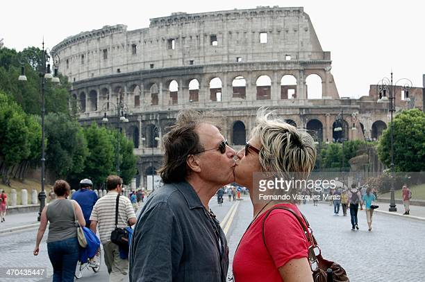 Couple demonstrating love in front of Colosseum
