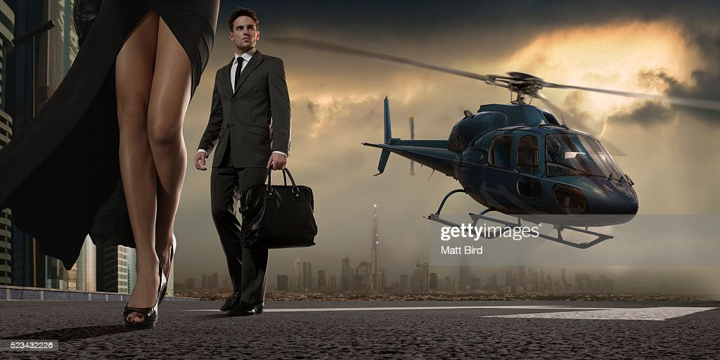 Couple departing helicopter : Stock Photo