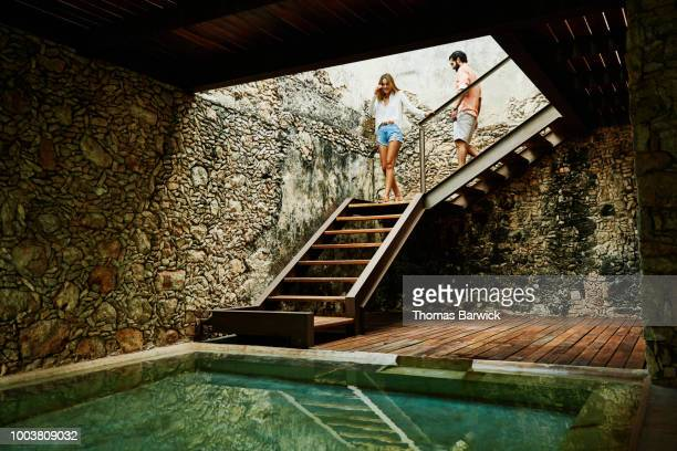 Couple descending stairs at spa in luxury resort