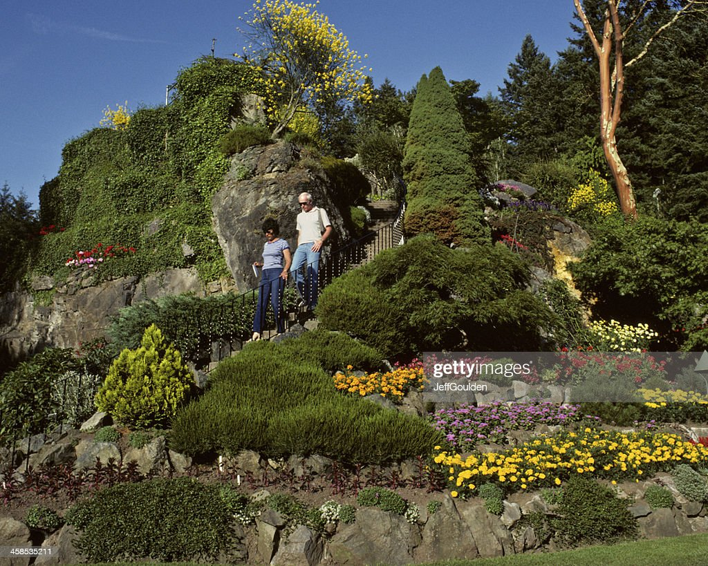 Couple Descending A Staircase At Butchart Gardens Stock Photo ...