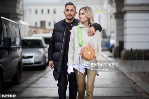 Couple Dima and Lisa Hahnbueck wearing Gianvito Rossi high heels MCM x Koenigsouvenir bag knit pants button shirt with long sleeves Dorothee...