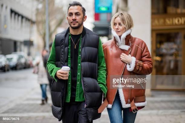 Couple Dima wearing black Balmain pants green cord button shirt Balmain Rick Owens vest and Lisa Hahnbueck wearing brown Acne Studios pistol leather...