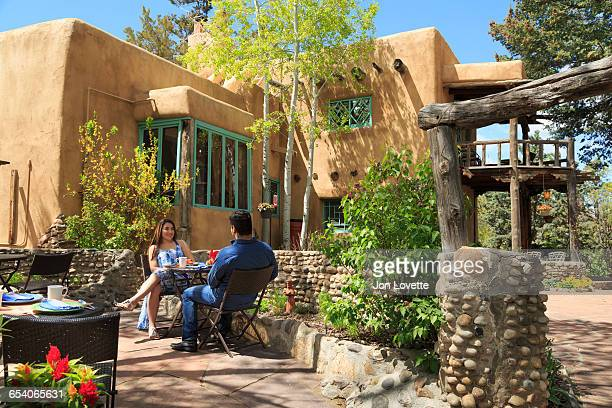 couple dining a bed and breakfast - santa fe new mexico stock pictures, royalty-free photos & images