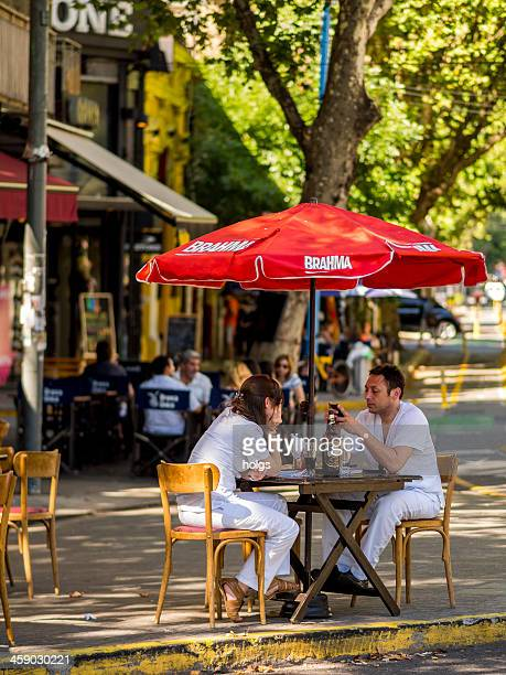 couple dining at outdoor restaurant, buenos aires, argentina - palermo buenos aires stock photos and pictures