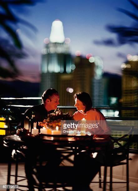 Couple dining on balcony