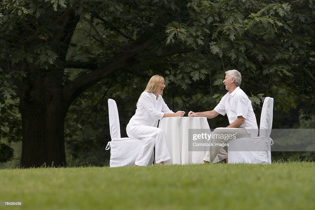 Couple dining outdoors : Stock Photo