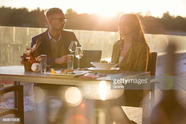 Couple dinning at sunset