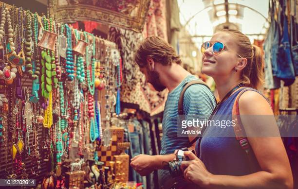 couple discover gifts market while travelling - tourist stock pictures, royalty-free photos & images