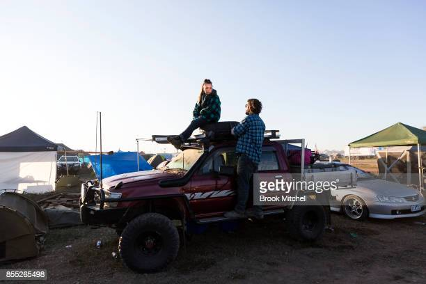 A couple discuss the previous nights events at dawn on day one of the 2017 Deni Ute Muster on September 29 2017 in Deniliquin Australia The annual...
